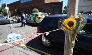 Floral tributes are left in Warham Street, where the attack took place.