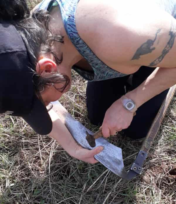 UK scything champion Andi Rickard 'peening' the blade of her scythe
