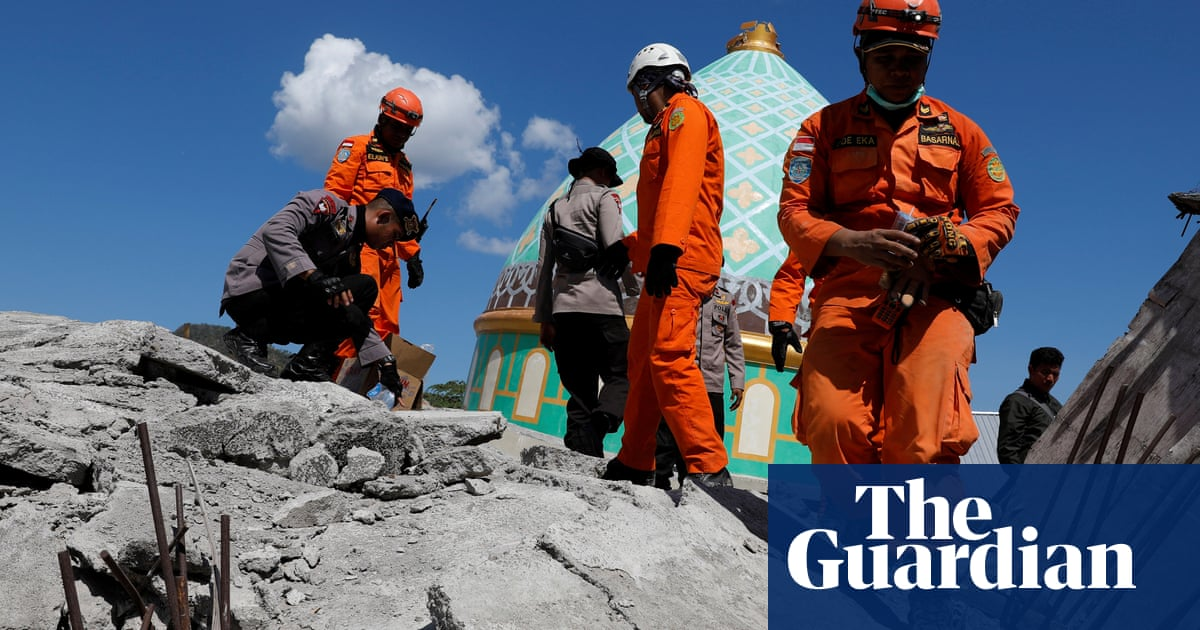 Indonesia earthquake: rescuers pull people alive out of rubble as aftershocks hi...