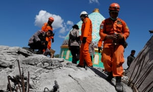 Rescuers search for survivors in a collapsed mosque on the Indonesian island of Lombok.
