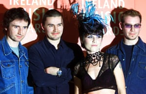 Noel Hogan, Mike Hogan, O'Riordan and Fergal Lawler after performing at the Meteor Ireland music awards in Dublin, 2002. The band split in 2003 for six years