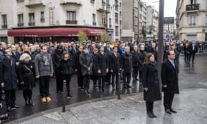 Francois Hollande, Anne Hidalgo and mourners stand in front of a plaque outside Le Carillon in Paris