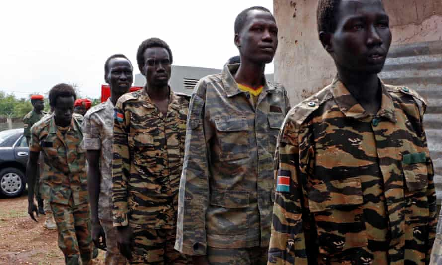 South Sudanese soldiers suspected of raping five foreign aid workers and killing a local colleague arrive at a military court in Juba