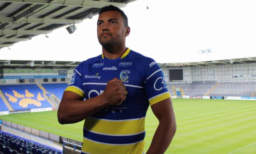 Luther Burrell, who played 15 Tests for England at rugby union, tries on his Warrington shirt for size.