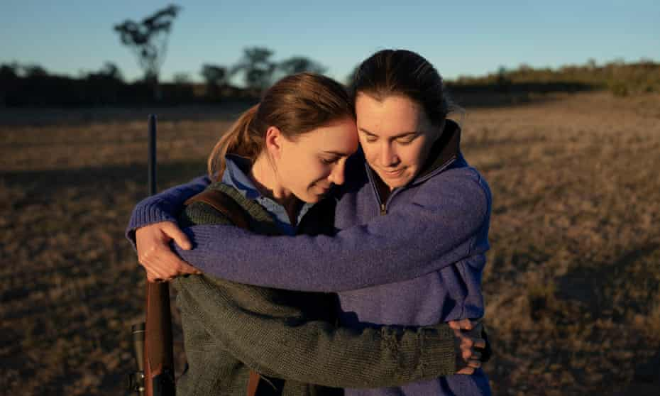 Warilalda farmer (L) Elizabeth Hollow, gets a hug from her twin sister Catherine on her drought affected property.