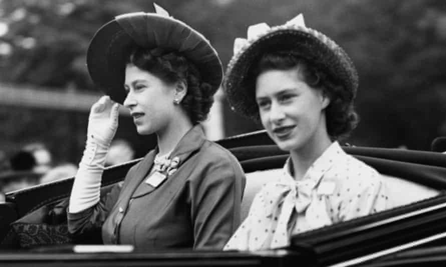 Princesses Elizabeth, left, and Margaret at Ascot for the Gold Cup in June 1948.