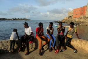 """Khadjou Sambe sits with beginners learning how to surf with Black Girls Surf (BGS). """"I always advise them not to listen to other people, to block their ears,"""" she said"""