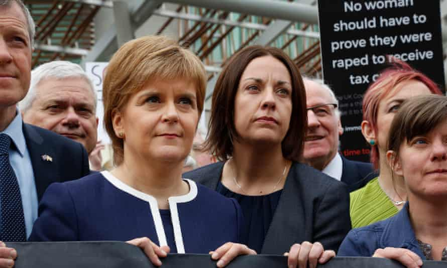 Nicola Sturgeon and the Scottish Labour leader, Kezia Dugdale, attend the 'rape clause' demonstration at Holyrood.
