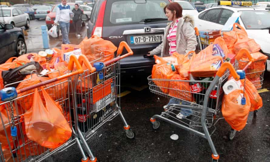 Gyn Farrell from Dublin fills her car full of shopping in Newry, Northern Ireland.