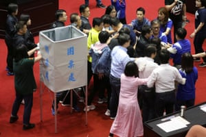 DPP lawmakers try to stop their KMT rivals from removing a voting booth