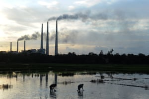 Indian labourers planting rice in front of Kolaghat Thermal Power Plant, 85km south-west of Kolkata.