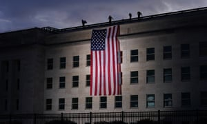 A large American flag is unfurled in the Pentagon before ceremonies at the National 9/11 Pentagon Memorial to honor the 184 people killed in the 2001 attack on the Pentagon.