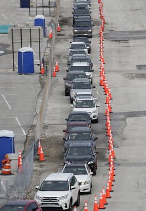 Lines of cars wait at a drive-through coronavirus testing site, Sunday, 5 July, 2020, outside Hard Rock Stadium in Miami Gardens, Florida.