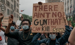 Protesters take to the street during a march against police brutality on Thursday in New York.