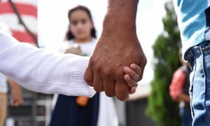 FILES-GUATEMALA-US-POLITICS-IMMIGRATION-CHILDREN<br>(FILES) In this file photo taken on July 10, 2018 a man holds his daughter by the hand after picking her and his wife up at the Air Force base in Guatemala City after they were deported from the United States. The federal judge who ordered the reunification of families separated at the southern US border said on August 3, 2018 it was the government's responsibility to locate parents deported without their children. / AFP PHOTO / Orlando ESTRADAORLANDO ESTRADA/AFP/Getty Images