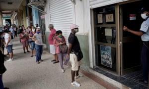 People wait in line to enter a currency exchange office in Havana, Cuba, 9 September 2020.
