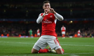 Ozil celebrates after scoring the fith in Arsenal 6-0 win, in which he scored a hat-trick.
