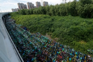 Thousands of rental bicycles sit near a flyover in Beijing's Tongzhou district