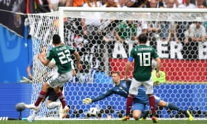 Hirving Lozano fires the ball inside Manuel Neuer's near post to put Mexico ahead.