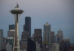Seattle, Washington, US. A rainbow flag flies at half mast on the Space Needle