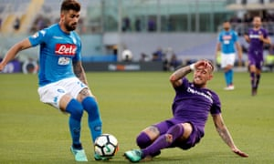 Napoli's Elseid Hysaj, left, tries to avoid a tackle from Fiorentina's Cristiano Biraghi.
