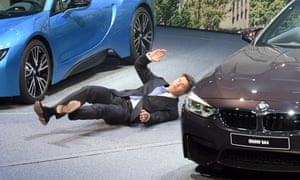 The dramatic moment the new BMW boss Harald Krüger faints during his presnetation at the Frankfurt motor show. Krüger is said to be recovering well.