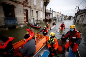 Saintes, France: Rescuers on small boats help residents in a flooded area as the Charente river overflows.