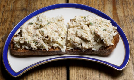 Cornish crab on toast with celeriac remoulade on a crescent-shaped dish