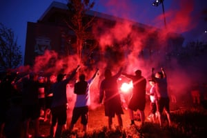Liverpool fans celebrate with flares outside Anfield after Chelsea scored their second goal in their match against Manchester City.