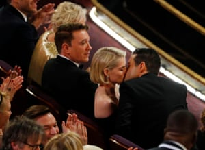 Rami Malek kisses his co-star and girlfriend Lucy Boynton before accepting the best actor award