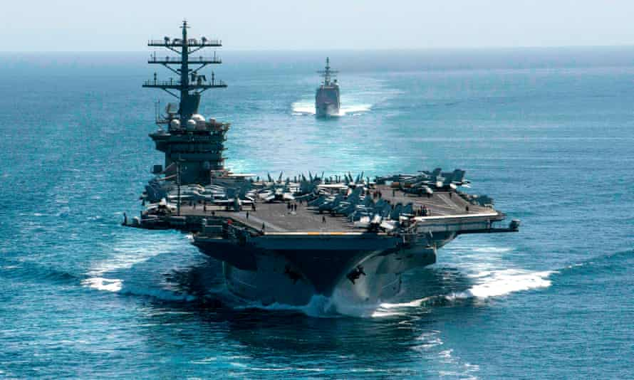 The aircraft carrier USS Nimitz and the guided-missile cruiser USS Philippine Sea in formation as they transit the Strait of Hormuz in the Persian Gulf.