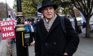 Sir Vince Cable walks past Brexit protesters outside parliament