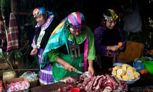 In this Feb. 10, 2013 photo, Mapuche Indian women prepare lunch in Ercilla, Chile. The Mapuche had secured treaties with the Chilean state recognizing their land as everything south of the Bio Bio River. But in the late 19th century, the treaties were breached in a violent takeover called the Pacification of the Araucania.