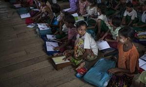Rohingya children attend school in the Dar Paing unregistered internal displacement camp in Sittwe, Myanmar.