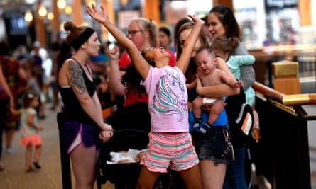 Kaleigh Arnett-Harris, eight, of Denver, celebrates being next in line.