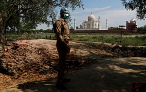A policeman wearing a protective mask stands guard near the historic Taj Mahal during a nationwide lockdown to slow the spread of COVID-19, in Agra, India, on 23 April 2020.