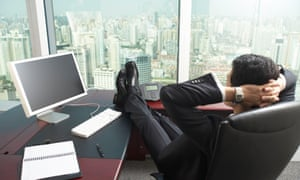 Businessman with feet up on desk in office
