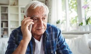 A senior man on mobile phone.