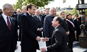 The outgoing French president, François Hollande (centre right), arrives to shake hands with Emmanuel Macron.