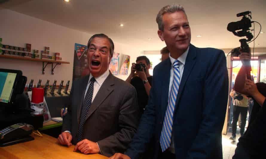 Brexit party leader Nigel Farage (left) and Brexit Party MEP candidate for Wales, Nathan Gill visit an e-cigarette and vape shop in Merthyr Tydfil, south Wales.