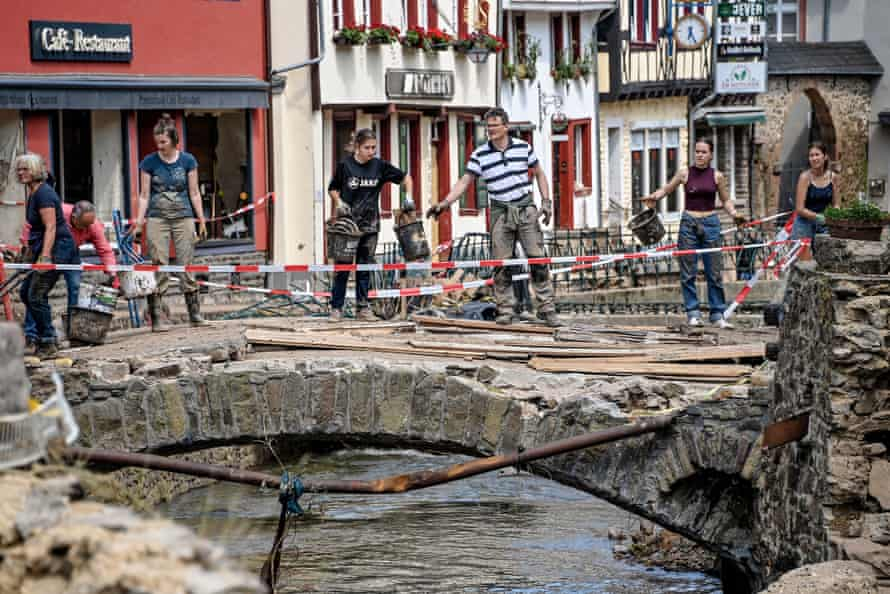 Residents clear debris in Bad Muenstereifel, Germany.