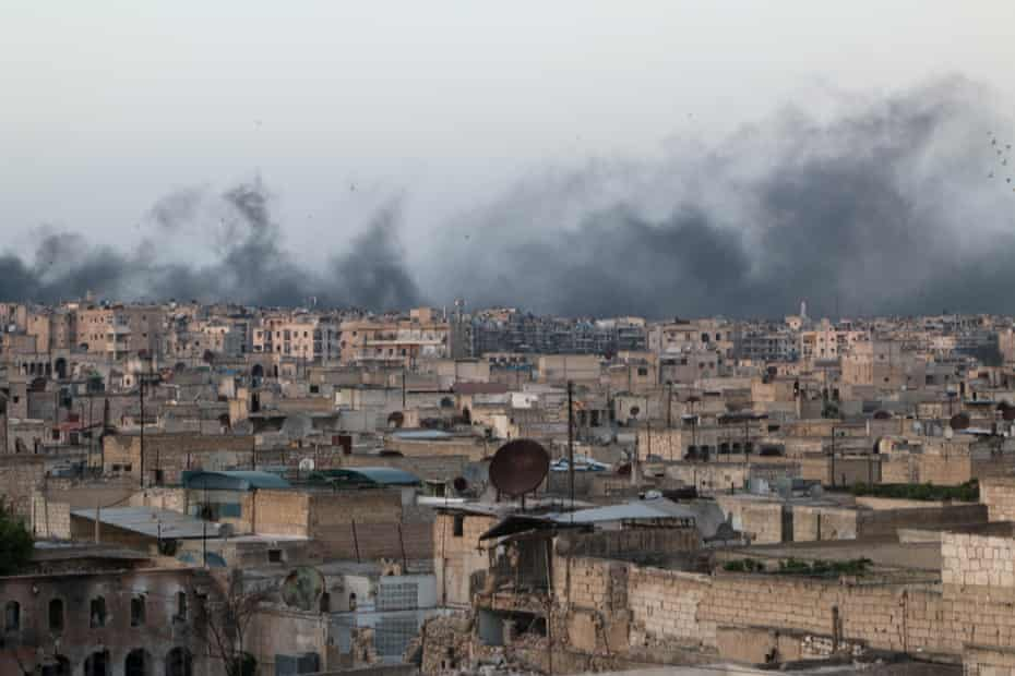 Smoke rises after airstrikes on the rebel-held al-Sakhour neighborhood of Aleppo, Syria, on Friday.