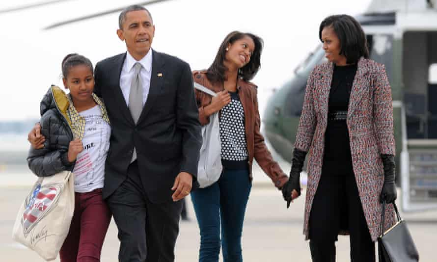 Michelle and Barack and their daughters Malia and Sasha board Air Force One
