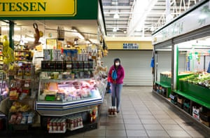 A woman wears a face mask as she does her shopping in Bradford's Oastler indoor market in May 2020