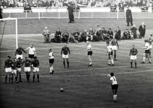England players form a wall as West Germany prepare to take a free-kick in the dying seconds of the game, The kick ricocheted off an England defender and eventually fell to Wolfgang Weber who poked the ball into the net, dramatically forcing extra time