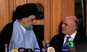 The Shia cleric Moqtada al-Sadr, left, with the Iraqi prime minister, Haider al-Abadi, at a press conference in June.