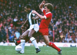 Cyrille Regis, playing for West Bromwich Albion, is challenged by Liverpool's Graeme Souness at Anfield in 1979.