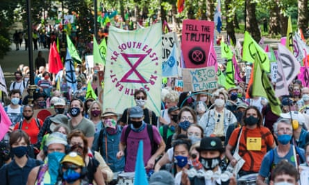 Extinction Rebellion protesters march to Parliament Square in central London.
