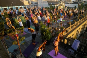 Prague, Czech Republic People take part in a yoga session on the roof of the Lucerna palace as the sun goes down in Prague