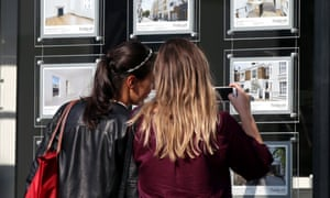 """Stamp duty impact on housing marketFile photo dated 08/06/16 of two young women studying houses for sale in an estate agent's window. The """"stifling"""" effect of stamp duty on the housing market means an extra 146,000 property sales could have taken place over the last five years if home movers had not been faced with the tax, a report has estimated. PRESS ASSOCIATION Photo. Issue date: Wednesday November 15, 2017. Despite reforms to stamp duty in recent years, it remains """"inefficient"""", the report argues, fuelling housing shortages, making homes less affordable and putting people off moving to more suitable properties - from those taking early steps on the housing ladder to older home owners. See PA story MONEY Stamp. Photo credit should read: Yui Mok/PA Wire"""